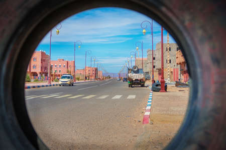 Wide angle shot through a used tire from the town of Tagonite in Draa Valley, Morocco
