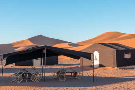 Desert camp in dunes of Erg Chigaga, at the gates of the Sahara. Morocco. Concept of travel and adventure.