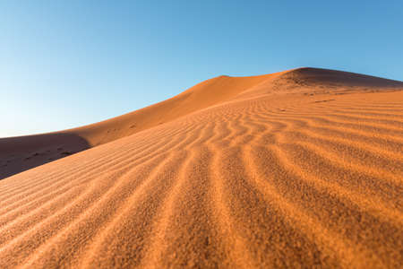 Daytime close-up desert dunes of Erg Chigaga, at the gates of the Sahara. Morocco. Concept of travel and adventure. Stockfoto