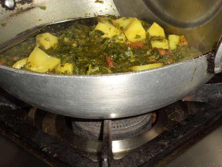 methi: Fenugreek leaves and potato pieces getting cooked