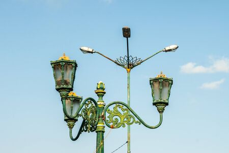 Juxtaposition of Streetlamps old and new Stock Photo