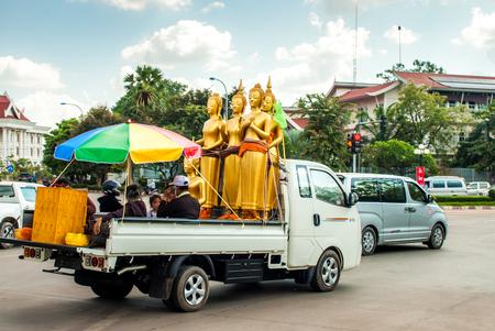 Vientiane, Laos - November 20, 2015: Buddha statues in traffic