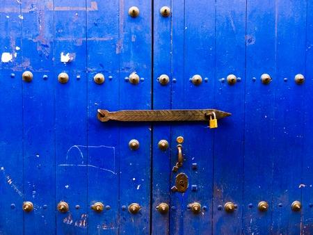 Heavy blue door in Cusco