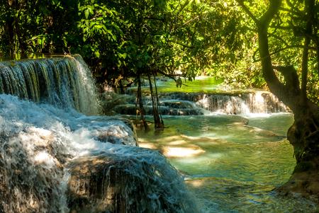 The idyllic Kuang Si Waterfall near Luang Prabang, Laos Stock Photo