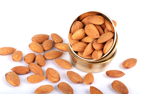 Almonds in bowl on wooden background, group of almonds, sackcloth Stock Photo
