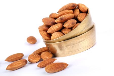 Almonds in bowl on wooden background, group of almonds, sackcloth Reklamní fotografie