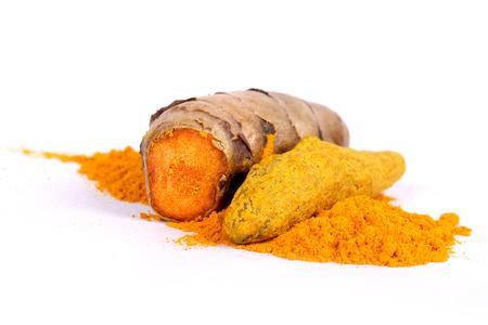 turmeric powder with fresh turmeric root in white