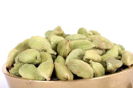 Spicy cardamom seeds close-up. Macro. Stock Photo