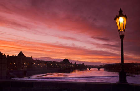 nightshot: View from Charles Bridge with shinning lamp and Vltava river at the sunset Stock Photo