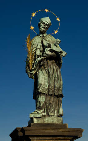 underlying: Photo of the ancient statue on the Charles bridge in Prague, Czech republic. From wiki: The avenue of 30 mostly baroque statues and statuaries situated on the balustrade forms a unique connection of artistic styles with the underlying gothic bridge. Most