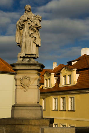 Photo of the ancient statue on the Charles bridge in Prague, Czech republic. From wiki: The avenue of 30 mostly baroque statues and statuaries situated on the balustrade forms a unique connection of artistic styles with the underlying gothic bridge. Most  photo