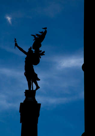 Statue of angel in Prague looks like ready to fly to heaven. photo