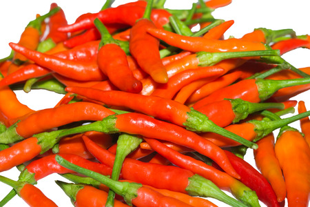 Pile of fresh, red, hot chili pepper on white, isolated