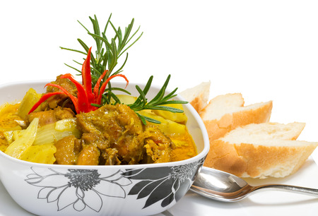 Spicy chicken curry served with breads Stock Photo