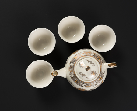 Set of antique dragon teapot and cups Stock Photo