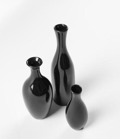 Set of ceramic black vases on white background