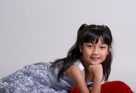 Cute, cheerful little girl in dress posing