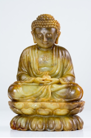 Jade Buddha meditation statue on white background Stock Photo