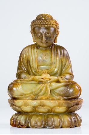 third eye: Jade Buddha meditation statue on white background Stock Photo