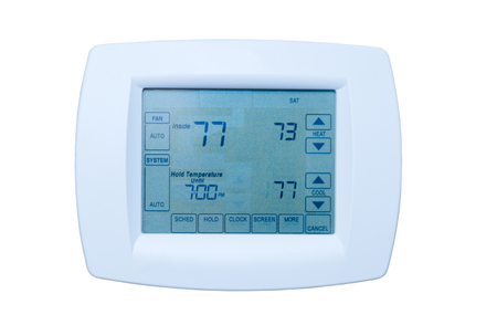 Programmable digital thermostat at energy efficiency optimal settings 73 degree heat, 77 air condition isolated