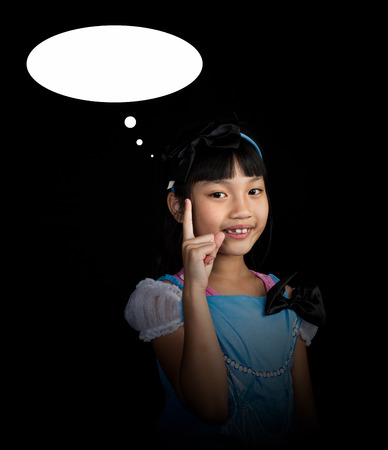 Cute, cheerful little girl thinking creative ideas on black background