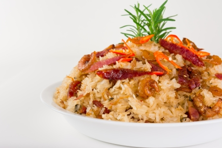 Delicious sticky rice with pork sausage, shrimps, chili pepper on white background