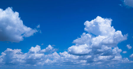 Beautiful blue sky with white clouds flowing toward horizon