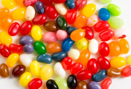 Colorful mixed jelly beans on white background