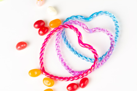 Symbol of love  Hearts connecting together, sweetening with jelly beans Stock Photo - 23454964
