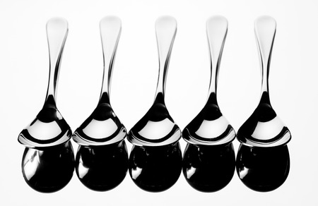 Set of stainless steel  spoon reflection on white  Stock Photo