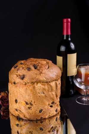 Delicious whole panettone, Christmas cake with glass, bottle of wine