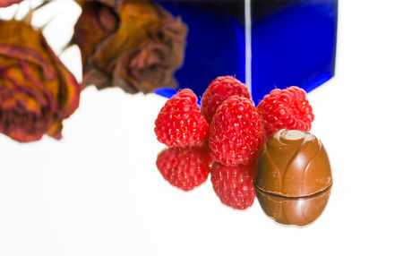 Delicious chocolate with raspberries  rose, blue vase   Wonderful environment for love