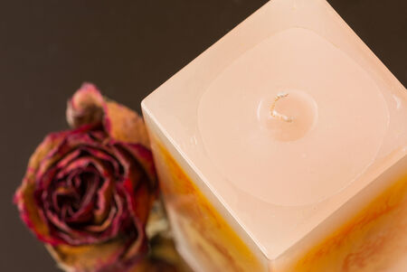 Peach vanilla scented block canle with dried rose bud  Stock Photo
