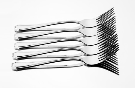 Set of stainless steel fork reflection on white background Stock Photo