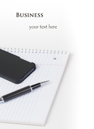 Business planning  Phone, pen, notepad with blank top for customized business advertising ad  Stock Photo