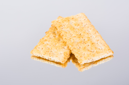 Fresh organic whole grain crackers reflection on mirror table backgroun
