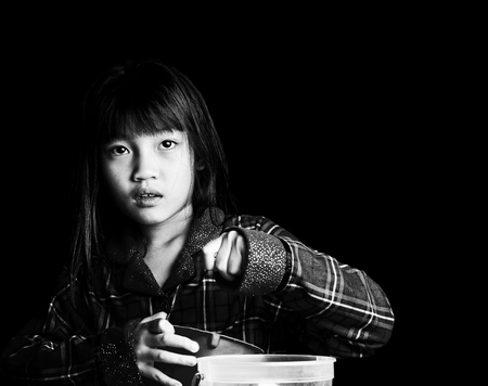 Little girl alone in the dark Stock Photo
