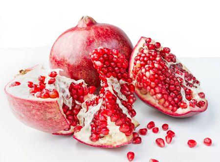 Fresh, ripe, organic pomegranate fruit on white background