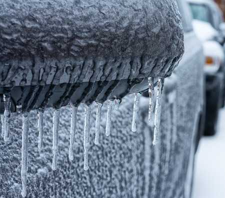 Lines of frozen icicle from vehicle side mirror  The sign of extreme cold and dangers  Stock Photo