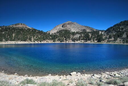 stone volcanic stones: Crystal clear lake in Lassen Volcanic National Park in California