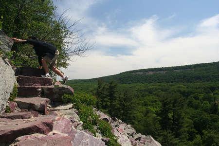 bluff: Man Climbing a Bluff