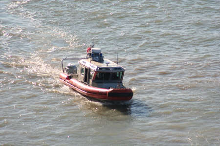 Official patrol boat zipping along in the water