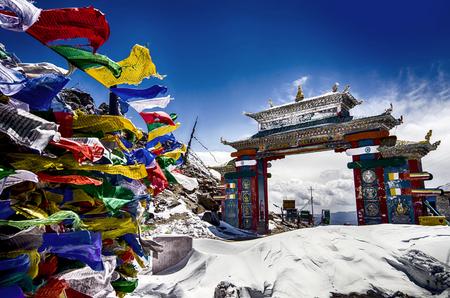 Tawang, Arunachal Pradesh, India. The Buddhist architecture, prayer flags and full of snow on a misty morning at Tawang, Arunachal Pradesh, North East India.