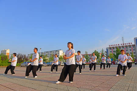 literary: Luannan - June 14: square in the center of the literary style taijiquan collective performance, June 14, 2014, luannan county, hebei province, China.