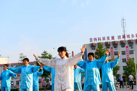poise: Luannan - June 14: taijiquan woman individual performances of close-up square in the center of the literary style, June 14, 2014, luannan county, hebei province, China. Editorial