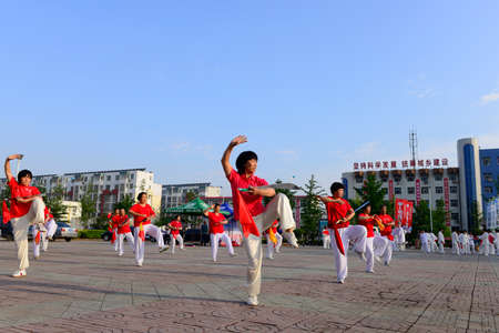 literary: Luannan - June 14: sabreplay collective performance square in the center of the literary style, June 14, 2014, luannan county, hebei province, China.