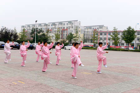 collective: Luannan - September 20: taijiquan collective performance in cultural activities square, on September 20, 2014, the south of the luanhe river, hebei, China. Editorial