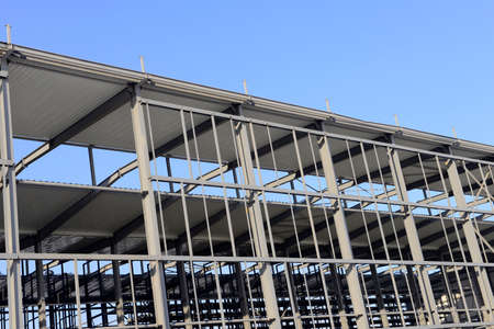 Is the construction of the steel structure factory building under the blue sky photo