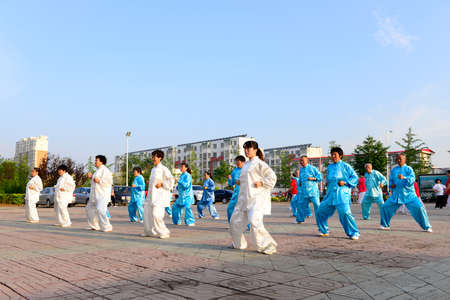 poise: Luannan - June 14: square in the center of the literary style taijiquan collective performance, June 14, 2014, luannan county, hebei province, China.