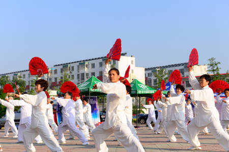 literary: Luannan - June 14: tai chi fan collective performance square in the center of the literary style, June 14, 2014, luannan county, hebei province, China.